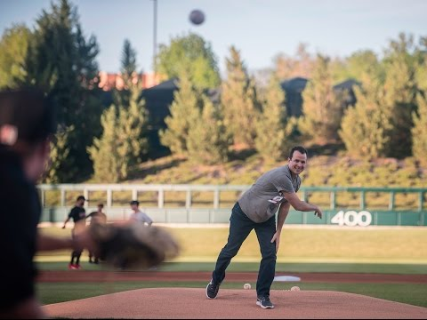 UNM Lobo Basketball Coach Paul Weir throws out first pitch at Isotopes game