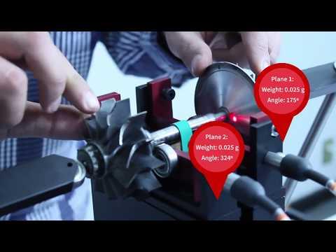 Balancing a turbofan using Soft Bearing Suspensions