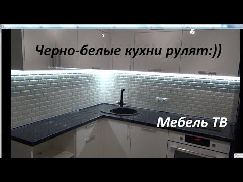 Белоснежная кухня с черной столешницей photo