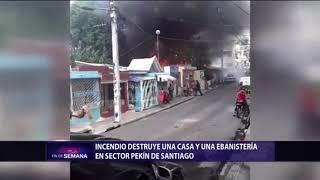 Incendio destruye una casa y una ebanistería en sector Pekín de Santiago