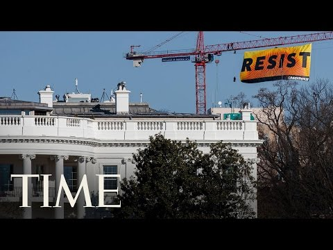 Protesters Climb Crane And Call For Resistance Blocks From White House   TIME