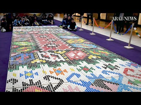 Rug made of 25 thousand plastic bottle caps on display