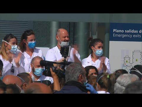 Healthworkers cheer as Madrid virus field hospital dismantled | AFP photo