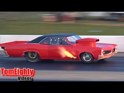Hollywood Bobby's GTO shooting flames and pulling wheelies