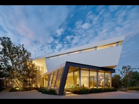 Modern Home Design with Unique Shape and Dynamic Vertical and Horizontal relationships Design Style
