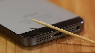 Use a toothpick to clean out your iPhone