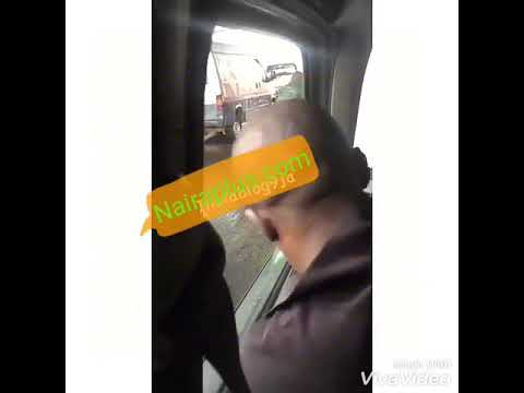 A Policeman And A Conductor Seen Fighting Over Bribe, In Oshodi, Lagos (Video)