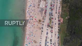 Greece: Locals flood Potamos Beach amid heatwave as coronavirus restrictions eased