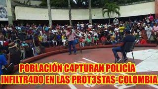 COLOMBIA POBLACIÓN C4PTURAN POLICÍA INFILTR4DO EN LAS PROT3STAS EN SECTOR DE LA LUNA EN CALI