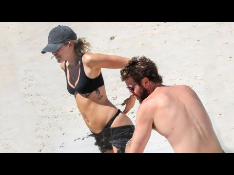 connectYoutube - Miley Cyrus and Liam Hemsworth Heat Things Up on the Beach -- See the Pics!