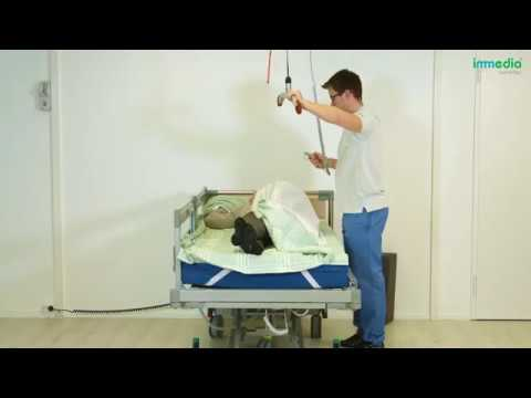 Turn the patient on their side using 4Direction DrawSheet Maxi and a ceiling hoist