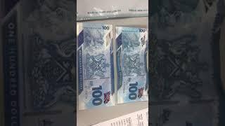 Trinidad Real and Fake Money $100 Dollar Bill