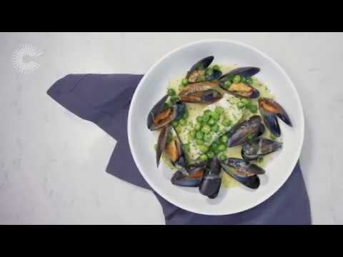 Poached cod loin with mussels, peas and parsley