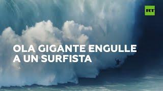 Una ola de 18 metros se 'traga' a un surfista en Portugal