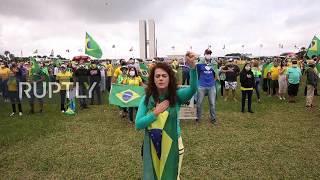 Brazil: Bolsonaro greets supporters at anti-lockdown rally in Brasilia