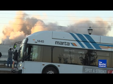 'Get out of the way!'  Bus parks directly in front of stadium implosion