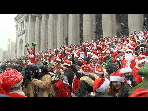Santas take over NYC and London in annual SantaCon