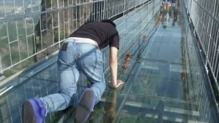 Tourists Brave Glass-Bottom Bridge