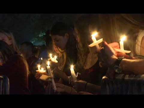 'No more guns': chants ring out at Florida shooting vigil