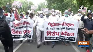 AAP workers protest against fuel price hike - INDIATV