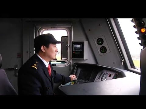 Train driver's story: From tracks to the Great Hall of the People