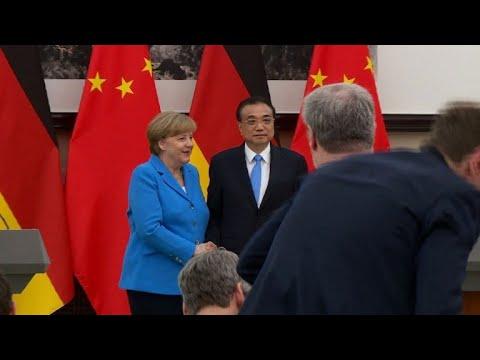 ميركل ورئيس وزراء الصين يدافعان عن الاتفاق النووي الايراني