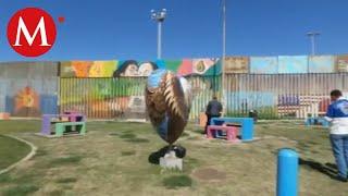 Pintan murales sobre valla fronteriza en Tijuana