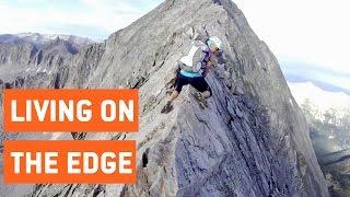 Climbers Walk Along Sharp Mountain Peak | Knife Edge