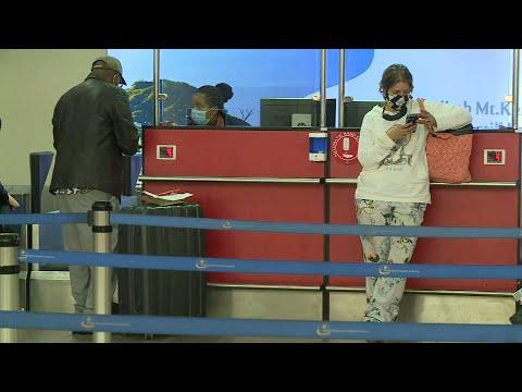 Passengers at airport after Kenya reopens for international flights | AFP photo