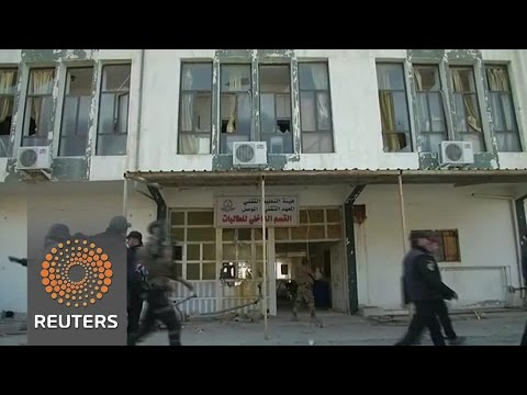 Iraqi forces fight IS at Mosul University