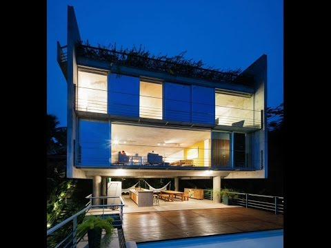 Modern House Design Built on 50% of Slope Topography Offering The View of Beach