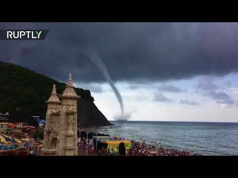 Meanwhile in Russia: People keep watching tornado instead of leaving the beach