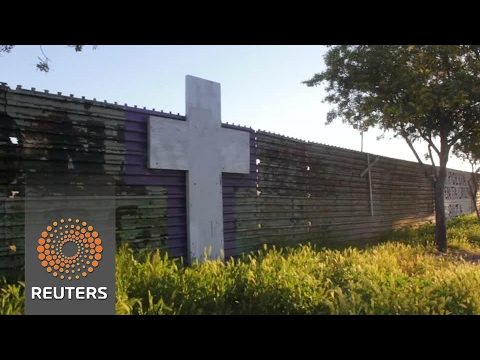 Families separated by U.S.-Mexican border meet at the fence