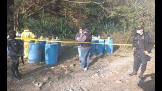 Localizan 21 toneles con productos químicos
