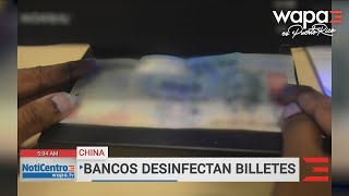 Bancos chinos desinfectan los billetes por el coronavirus