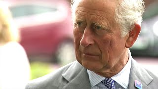 Prince Charles and Camilla meet staff at shirt-turned-PPE factory
